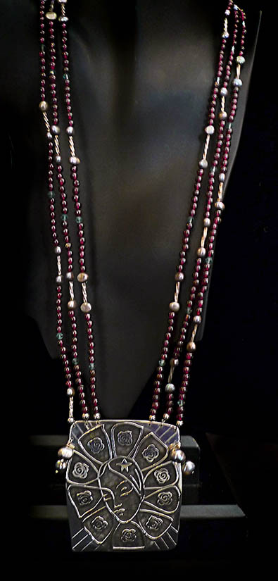Our Lady of Guadalupe in sterling silver, garnets, pearls and crystal